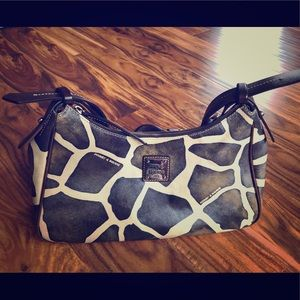Dooney & Bourke giraffe print purse.